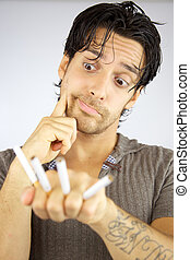 Man with cigarettes funny face - Cool man with funny face...