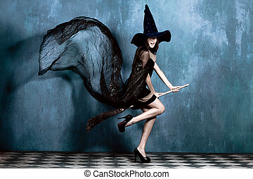 teen witch on her broom ready to fly