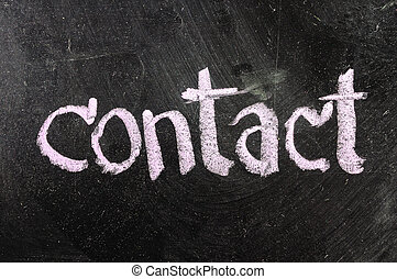 Contact handwritten with white chalk on a blackboard