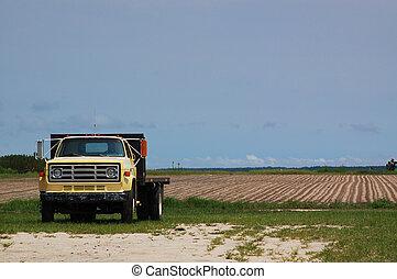 Farm Truck - Rusty old truck in front of a fallow field...