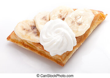 Banana Tart Slices with fresh vanilla cream on white dish