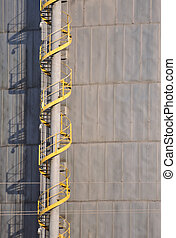 Industrial Stairs - Yellow staircase spiraling to the top of...