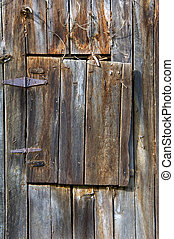 Aging Loft Door - Weathered wood, leather and iron hinges...