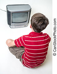 Boy watching Television - A young teenage boy watching...