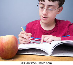 Middle school student doing work - A student working at...