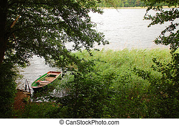 Boat on the Lake - Row-boat moored to the bank of Roblinsee...