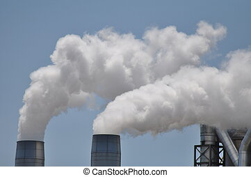 Industry Smoke Stacks - Smoke stacks billowing out steam and...