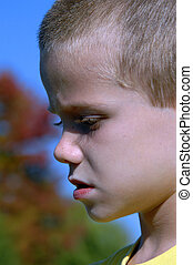 Freckles and long lashes - Closeup of small boy standing...