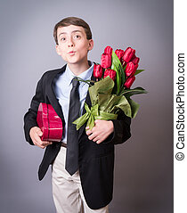 Valentines Day - A young teen boy with heart shaped box of...
