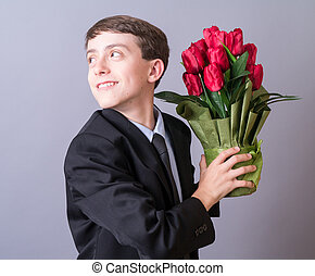 Romeo - A young teen boy dressed up with flowers for his big...