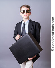 Young Business man with briefcase - A successful teenage...