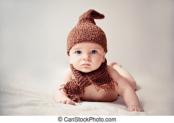 newborn baby in a cap and scarf