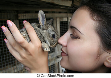 Closeup portrait of a pretty girl with a rabbit