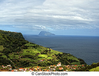 acores; flores, view to corvo - small volcano island of...
