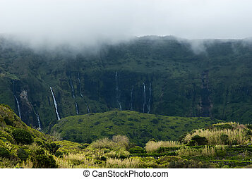 cloudy mountains of flores, acores islands - green and foggy...