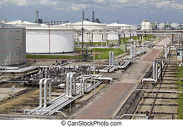 Oil Refinery and Silos - Silos and pipes of an oil refinery...