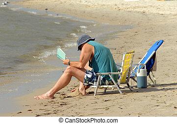 Assateague Island Getaway - Man holding a book playfully...