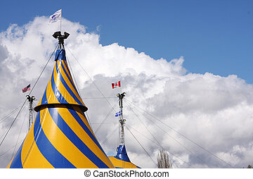 Circus Tents - Tops of circus tents against a cloudy sky.