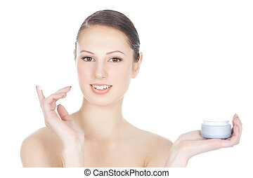 Beautiful young brunette girl with facial cream - Picture of...