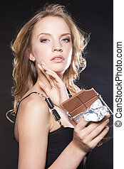 portrait of beautiful woman with a chocolate