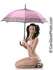 sexy brunette sitting in profile with umbrella