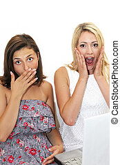 Two women reacting in shocked awe - Two women reacting in...