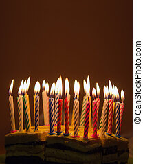 Birthday cake - Background of lighted candles on top of...