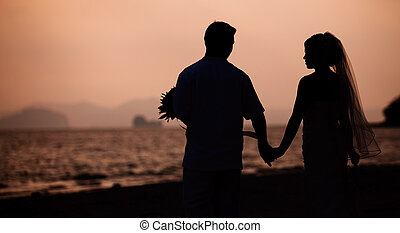 Romantic scene of love couples on the beach