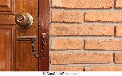 wooden door with locker and red brick