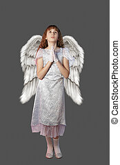 Angel girl - Girl with angel wings on gray background.