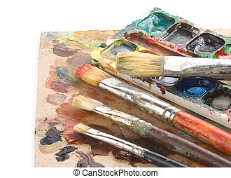 brush and art palette with paints