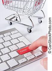E-shop concept - E-shop (e-commerce) concept - keyboard with...