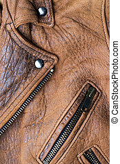 Brown leather jacket - Close-up of a worn brown leather...