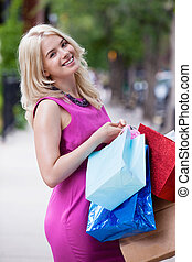 Woman with Shopping Bags - Profile portrait of happy woman...