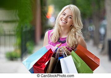 Happy Shopaholic Woman - Portrait of a beautiful young woman...