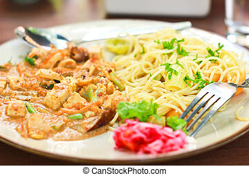 vegetarian spaghetti with spoon and fork