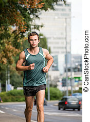 Training - man running in street