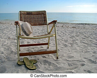 beach chair - wicker beach chair with hat and sandals