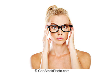 Beautiful woman nerd with a wide eyed expression and raised...