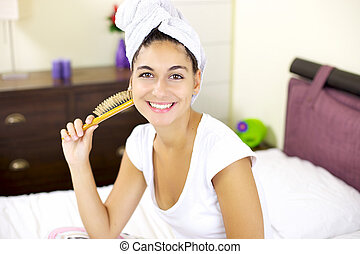 Cute girl at home after hair wash with towel on her head -...
