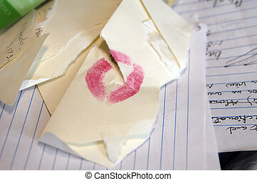 Valentine-less - Envelope with lipstick lies in the trash...