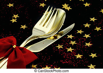 Christmas cutlery. Spoon, fork and knife stacked up on a...