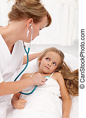Sick girl examined by female doctor