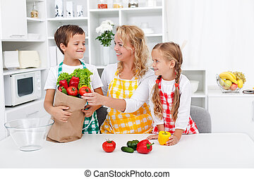 Healthy nutrition concept with people in the kitchen