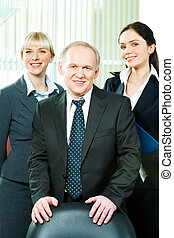 Business team - Image of business team together with boss in...