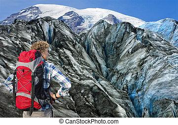 Mountaineer facing his challenge - Hiker overlooking the...