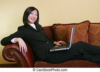 home based business woman working - young attractive asian...