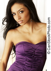 Beautiful woman in purple dress