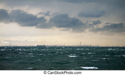 approaching storm - stormy seascape with industrial chimneys...