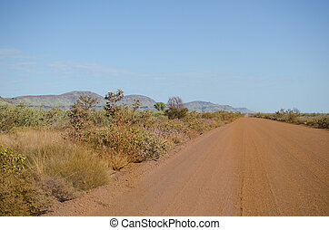 Outback Australia, Travel Holiday - Dirt gravel road in...